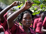 A woman waves a branch and sings as she and other Catholics participate in a procession through the streets of Juba on November 20 to pray for a peaceful January 2011 referendum on Southern Sudan's secession from the north of the country. The independence vote has widespread support throughout Southern Sudan, including among Christians.