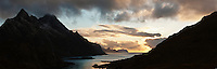 Evening light over coastline, Maervoll, Vestvagoy, Lofoten Islands, Norway