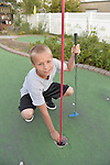 Freeport, New York, U.S. September 6, 2013. MATT T, 11, visiting family in Long Island, plays miniature golf at Crow's Nest Mini Golf at the Nautical Mile.