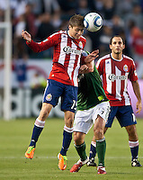 CARSON, CA – June 3, 2011: Chivas USA midfielder Jorge Flores (19) heads the ball during the match between Chivas USA and Portland Timbers at the Home Depot Center in Carson, California. Final score Chivas USA 1, Portland Timbers 0.