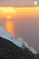 Italy, Sicily, Stromboli Island, Fumaroles smoke from Stromboli Volcano and Mediterranean Sea at sunset (Licence this image exclusively with Getty: http://www.gettyimages.com/detail/sb10069714r-001 )