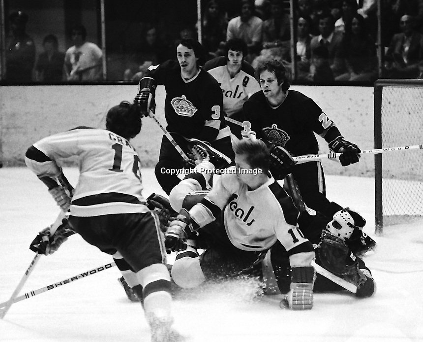 Seals vs Kings: pile up in front of the LA net. Hilliard Graves and Stan Gilbertson, Kings Larry Brown and Neil Komadoski.& goalie Rogie Vachon. (1973-74 Photo by Ron Riesterer)