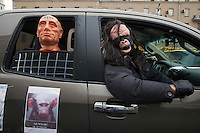 "Moscow, Russia, 26/02/2012..A car in a motorcade with a Putin mannequin apparently behind bars and with the word ""thief"" on his forehead. Tens of thousands of people formed a 16-kilometre [10-mile] human chain along Moscow's Garden Ring Road in the latest protest against Prime Minister Vladimir Putin and his presidential election campaign. Opposition activists estimated that they needed 34,000 people to complete the chain and symbolically encircle central Moscow."