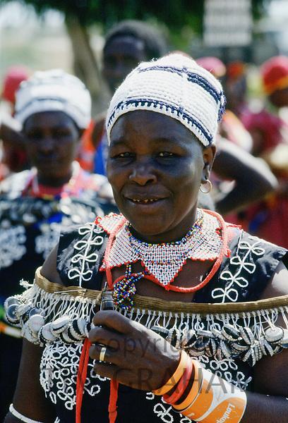 Woman wearing traditional dress, Kenya, Africa