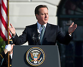 Prime Minister David Cameron of Great Britain makes remarks as he and his wife, Samantha, are welcomed to the White House in Washington, D.C. by United States President Barack Obama and first lady Michelle Obama (not pictured) on Wednesday, March 14, 2012..Credit: Ron Sachs / CNP