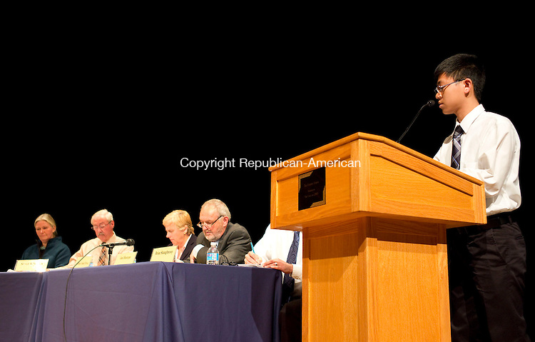 Winsted, CT- 22 October 2015-102215CM03-  Winsted student, Jacob Tran asks a question to candidates during a debate in Winsted on Thursday.  Candidates for the Board of Selectmen answered election-based questions from The Gilbert School students.  Christopher Massa Republican-American