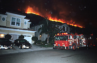 870000321 la county firemen work to protect private homes in agoura as the topanga wildfire flares up on a nearby ridge in los angeles county california