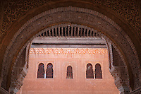 Horseshoe arch in carved stucco in the portico of the Patio of the Gilded Room, between the Mexuar and the Gilded Room or Cuarto Dorado in the Comares Palace, with intricately carved wall with latticed windows beyond, Alhambra Palace, Granada, Andalusia, Southern Spain. It was built under Mohammed V in the 14th century. The Alhambra was begun in the 11th century as a castle, and in the 13th and 14th centuries served as the royal palace of the Nasrid sultans. The huge complex contains the Alcazaba, Nasrid palaces, gardens and Generalife. Granada was listed as a UNESCO World Heritage Site in 1984. Picture by Manuel Cohen