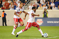 Dane Richards (19) of the New York Red Bulls shoot and scores as Thierry Henry (14) looks on. The New York Red Bulls defeated the San Jose Earthquakes 2-0 during a Major League Soccer (MLS) match at Red Bull Arena in Harrison, NJ, on August 28, 2010.