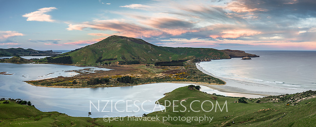 Allans Beach with Hoopers Inlet on left during seting sun. Mt. Charles in centre, Otago Peninsula, Coastal Otago, East Coast, New Zealand