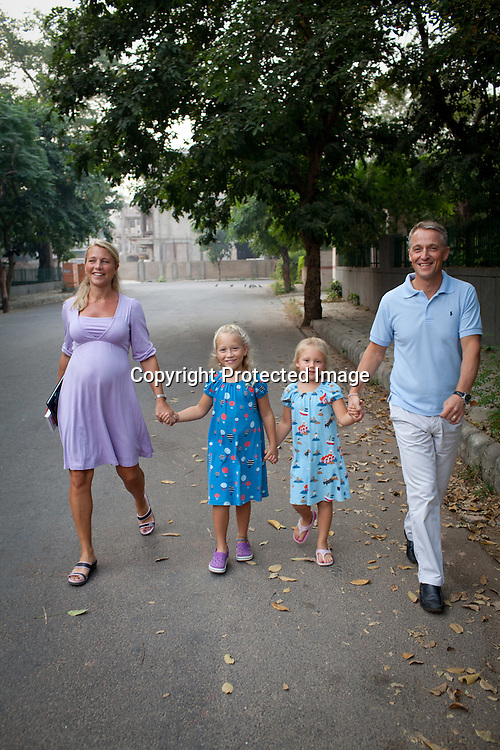 Magnus Oskarsson and his wife Cecilia Oskarsson seen walking around in their neighbourhood with their two daughters, Iris and Siri in their home in New Delhi, India. Photo: Sanjit Das