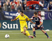 Columbus Crew midfielder Dilly Duka (11) dribbles as New England Revolution midfielder Kelyn Rowe (11) defends. In a Major League Soccer (MLS) match, the New England Revolution defeated Columbus Crew, 2-0, at Gillette Stadium on September 5, 2012.