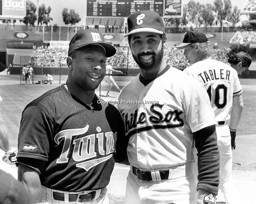 Twins Kirby Puckett and White Sox Harold Baines in Oakland for the 1987 AllStar game. (photo/Ron Riesterer)