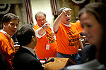 Wisconsin Democratic Rep. Andy Jorgensen, center left, and Rep. Brett Hulsey yell at Republican representatives as they leave the Assembly chambers after manuevering to quickly pass a bill to eliminate collective bargaining at the State Capitol in Madison, Wisconsin, February 25, 2011.