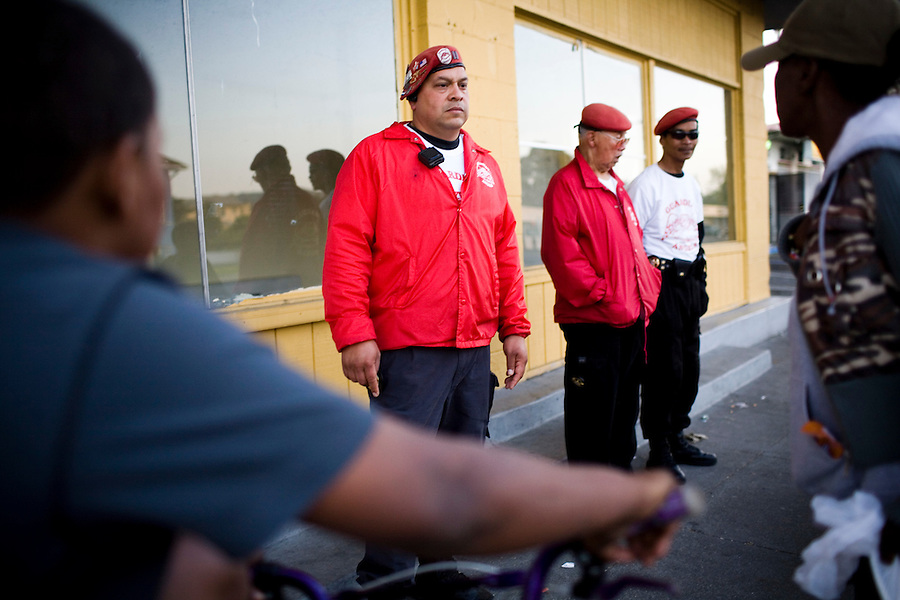 CQ) (L-R) A prostitute and drug user, at right, approaches Omar Martinez, 41, Ernie Aguada, 75, and Ed Robancho, 52, of the Guardian Angels, an all-volunteer neighborhood watch group, patrol Sonoma Blvd and watch for crime, drugs and prostitution, in Vallejo, Ca., on Monday, April 11, 2011. The city of Vallejo claimed bankruptcy in 2008, and has drastically cut back, fired employees, and reduce salaries of the police and fire departments, which eventually caused a surge in crime and prostitution.