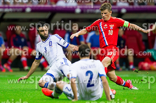 Andrey Arshavin of Russia (R) vs Giorgos Tzavellas  of Greece and Giannis Maniatis  of Greece  during the UEFA EURO 2012 group A match between  Greece and Russia at The National Stadium on June 16, 2012 in Warsaw, Poland.  Greece defeated Russia 1-0 and qualified to Quarterfinals. (Photo by Vid Ponikvar / Sportida.com)