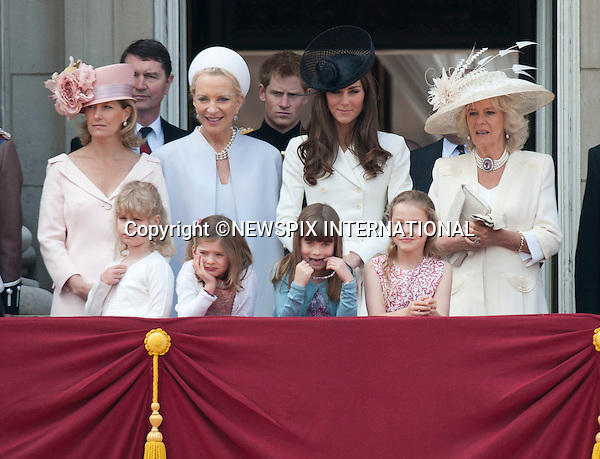 "TROOPING THE COLOUR 2011.Catherine explains to the excited girls how the view looked on her wedding day..The Duchess of Cambridge also did a quick demonstration of Laura Lopes covering her ears..Catherine, The Duchess of Cambridge at her first Trooping the Colour.The Duchess of Cambridge shared a carriage with The Duchess of Cornwall, Prince Harry and the Duke of York. Prince William accompanied his Farther Prince Charles on horse back for the first time along with Princess Anne and the Duke of Kent.The Second carriage was occupied by The Count and Countess of Wessex, Lady Louise and Princess Eugenie_Buckingham Palace, London_11/06/2011..Mandatory Photo Credit: ©Dias/Newspix International..**ALL FEES PAYABLE TO: ""NEWSPIX INTERNATIONAL""**..PHOTO CREDIT MANDATORY!!: NEWSPIX INTERNATIONAL(Failure to credit will incur a surcharge of 100% of reproduction fees)..IMMEDIATE CONFIRMATION OF USAGE REQUIRED:.Newspix International, 31 Chinnery Hill, Bishop's Stortford, ENGLAND CM23 3PS.Tel:+441279 324672  ; Fax: +441279656877.Mobile:  0777568 1153.e-mail: info@newspixinternational.co.uk"