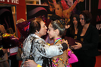 Anna Trubnikova of Russia (junior) is congratulated by coach after winning junior AA at 2010 Grand Prix Marbella at San Pedro Al Cantara, Spain on May 14, 2010.  (Photo by Tom Theobald).