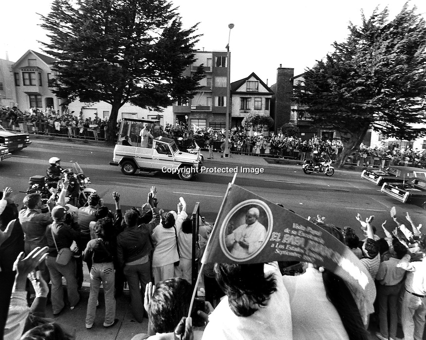 Pope John Paul in Pope Mobil riding down Geary Blvd. in San Francisco during 1978 visit to San Francisco and the Bay Area. (photo/Ron Riesterer)