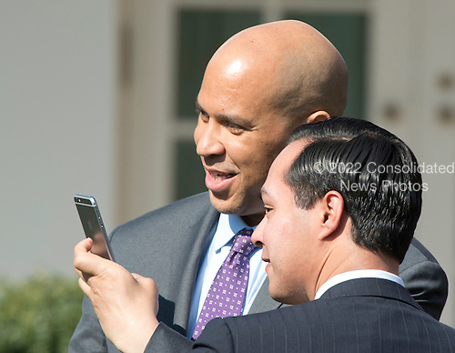 United States Senator Cory Booker (Democrat of New Jersey), member, US Senate Judiciary Committee, and US Secretary of Housing and Urban Development Juli&aacute;n Castro, pose for a &quot;selfie&quot; prior to US President Barack Obama introducing Judge Merrick Garland, chief justice for the US Court of Appeals for the District of Columbia Circuit, as his nominee to replace the late Associate Justice Antonin Scalia on the U.S. Supreme Court in the Rose Garden of the White House in Washington, D.C. on Wednesday, March 16, 2016. <br /> Credit: Ron Sachs / CNP