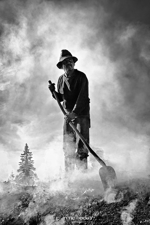 Faraway Look<br /> Charcoal Burner at work. Hargita, Romania.