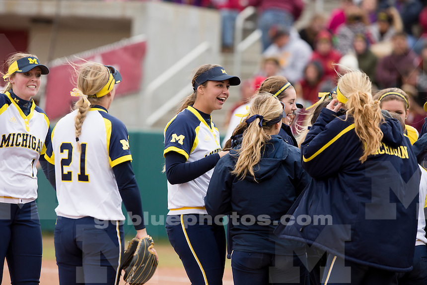 Michigan's Tera Blanco, center, is seen during an NCAA college softball game on Saturday, April 2, 2016, in Bloomington, Indiana. (Photo by James Brosher)