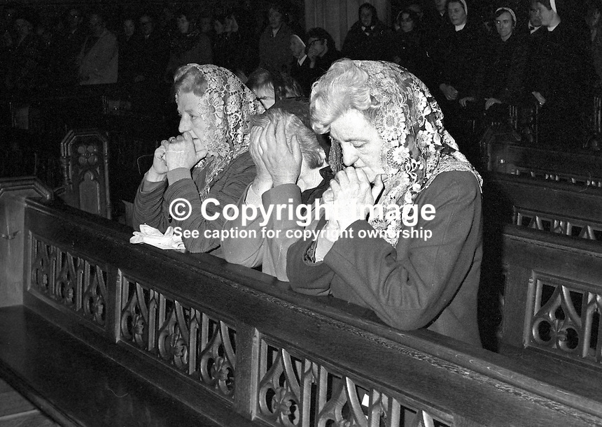 Funeral of Cardinal William Conway,  Archbishop of Armagh, Primate of All Ireland - The cardinals mother and two sisters pray during the Requiem Mass at St Patrick's Cathedral, Armagh. The cardinal died 17th April 1977. 197704190054a.   <br /> <br /> Copyright Image from Victor Patterson, 54 Dorchester Park, Belfast, UK, BT9 6RJ<br /> <br /> t1: +44 28 9066 1296 (from Rep of Ireland 048 9066 1296)<br /> t2: +44 28 9002 2446 (from Rep of Ireland 048 9002 2446)<br /> m: +44 7802 353836<br /> <br /> e1: victorpatterson@me.com<br /> e2: victorpatterson@gmail.com<br /> <br /> www.victorpatterson.com<br /> <br /> IMPORTANT: Please see my Terms and Conditions of Use at www.victorpatterson.com