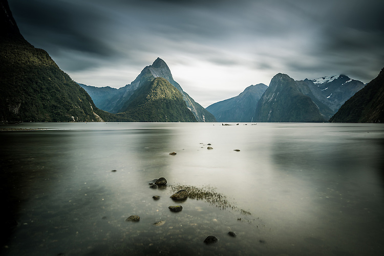 Changing weather is captured in a long exposure of Mitre Peak and Milford Sound, in Fiordland National Park, south Island, New Zealand.
