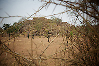 May 02, 2012 - Kauda, Nuba Mountains, South Kordofan, Sudan: A field commander of Sudan Peoples Liberation Movement (SPLA-N) walks by in Jebel Kwo military base near Tess village in the rebel-held territory of the Nuba Mountains in South Kordofan. ..SPLA-North, a historical ally of SPLA, South Sudan's former rebel forces, has since last June being fighting the Sudanese Army Forces (SAF) over the right to autonomy and of the end of persecution of Nuba people by the regime of President Bashir. (Paulo Nunes dos Santos/Polaris)