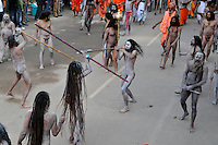 Naga Sadhus (naked saints) show their skills of fighting before going for the  holy dip during the first Sahi Snan (Royal dip) at Kumbh mela on 12th February 2010. Haridwar, Uttara Khand, India, Arindam Mukherjee