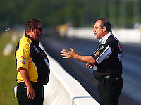 Jun 3, 2016; Epping , NH, USA; NHRA top fuel crew chief Brian Corradi (right) talks with NHRA safety safari official Jeff Parker during qualifying for the New England Nationals at New England Dragway. Mandatory Credit: Mark J. Rebilas-USA TODAY Sports