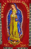 A bright red banner from La Danza Azteca Chichimeca celebrates the 2005 Virgin of Guadalupe Feast day, December 12, in Juarez, Mexico