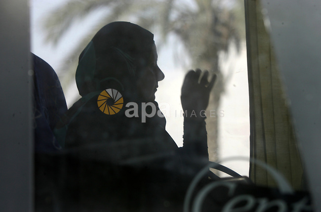 Palestinians Muslim pilgrims wave as they sit in a bus before leaving the Rafah border crossing between Egypt and the southern Gaza Strip, on Sept. 18, 2014, before leaving for the annual hajj pilgrimage to the holy city of Mecca. Hundreds of Palestinian pilgrims are leaving Gaza strip through the Rafah crossing on their way to Mecca, Saudi Arabia, for hajj. Photo by Abed Rahim Khatib