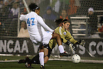04 December 2009: Notre Dame's Nikki Weiss (in gold) makes a save against North Carolina's Jessica McDonald (47). The University of North Carolina Tar Heels defeated the Notre Dame University Fighting Irish 1-0 at the Aggie Soccer Complex in College Station, Texas in an NCAA Division I Women's College Cup Semifinal game.