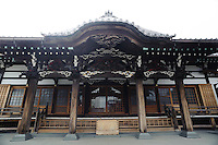 """Temple, Yanaka, Tokyo, Japan, April 20, 2012. Yanaka is part of Tokyo's """"shitamachi"""" historic working class wards. Recently it has become popular with Japanese and foreign tourists for its many temples, shops, restaurants and relaxed atmosphere."""