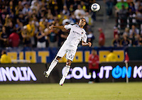 LA Galaxy defender Leonardo (22) makes a leaping header. The LA Galaxy and the San Jose Earthquakes played to a 2-2 draw at Home Depot Center stadium in Carson, California on Thursday July 22, 2010.