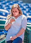 Washington Nationals Senior Director of Baseball Communications Amanda Comak checks a message during batting practice prior to a game against the Philadelphia Phillies at Nationals Park in Washington, DC. The Nationals defeated the Phillies 2-1 in the first game of their 3-game weekend series. Mandatory Credit: Ed Wolfstein Photo *** RAW (NEF) Image File Available ***