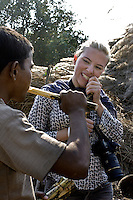 Scarlett trys chewing sugar cane in the village of Revasada close by to the school of Purvaiachal dalit Balika school in Ghazipur district.
