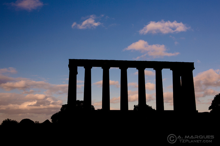 Silhouette of the  National Monument of Scotland, located on Calton Hill, Edinburgh, Scotland.  .Modelled on the Parthenon (Athens), the National Monument of Scotland is a memorial to the Scottish soldiers that died on the Napoleonic Wars.  .Construction started in 1826 and was interrupted in 1829. It's still unfinished.
