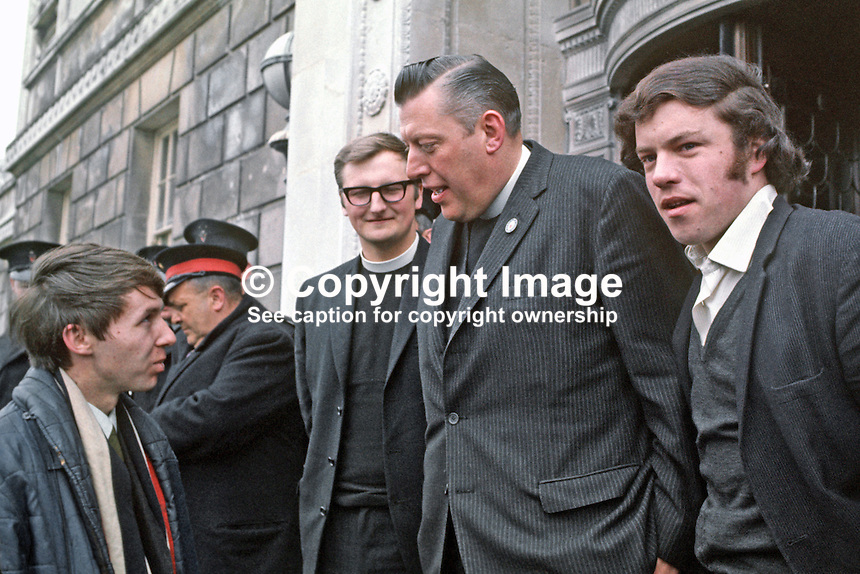 Protestant Unionist MPs, Rev Ian Paisley, accompanied by Rev William Beattie, arrive at Parliament Building, Stormont, to take their seats following by-election successes in Bannside and South Antrim. 197004210118b.<br />