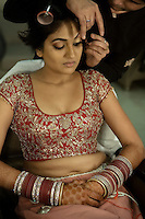 Delhi, India, January 21st, 2011. Sumedha is getting ready for the ceremony the day of her marriage in a salon in Delhi.
