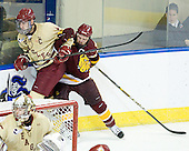 Tommy Cross (BC - 4), Jake Hendrickson (Duluth - 15) - The Boston College Eagles defeated the University of Minnesota Duluth Bulldogs 4-0 to win the NCAA Northeast Regional on Sunday, March 25, 2012, at the DCU Center in Worcester, Massachusetts.