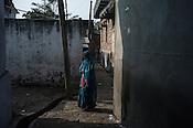 An old woman stands at crossroads in village Medawar Kalan in Ballia district of Uttar Pradesh, India. Photo: Sanjit Das/Panos for Der Spiegel