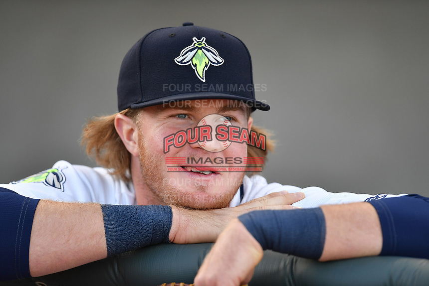 First baseman Dash Winningham (34) of the Columbia Fireflies in the dugout before a game against the Augusta GreenJackets on Opening Day, Thursday, April 6, 2017, at Spirit Communications Park in Columbia, South Carolina. (Tom Priddy/Four Seam Images)