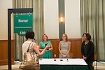 Representatives from the Bursar's office talk with Associate Professor of English & Chair of Faculty Senate Beth Quitslund (Left) at the Your Passport to the OHIO Guarantee event. Photo by Ben Siegel/ Ohio University