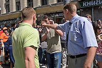 Moscow, Russia, 27/05/2007..A plain clothes policeman punches a masked nationalist in the face after he spat on a lesbian demonstrator at Moscow's second attempted Gay Pride parade. The parade had already been banned by Moscow Mayor Yuri Luzhkov on the grounds that it would provoke violence, but gay activists attempted to demonstrate in defiance of the ban, and many were beaten by counter demonstrators and arrested by police.