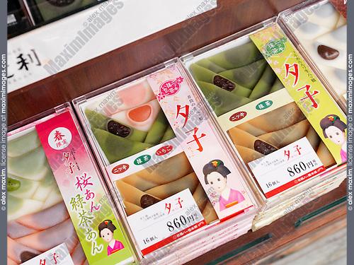 Yatsuhashi souvenir sweets Miyagegashi on a store display in Kyoto, Japan.