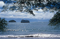 Small cruise ship anchored off Manuel Antonio National Park on the Pacific Coast of Costa Rica