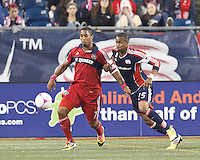 Chicago Fire forward Sherjill MacDonald (7) attempts to control the ball as New England Revolution defender Darrius Barnes (25) pressures. In a Major League Soccer (MLS) match, the New England Revolution (blue) defeated Chicago Fire (red), 1-0, at Gillette Stadium on October 20, 2012.