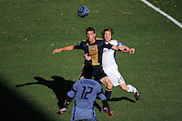 Sebastien Le Toux (9) of the Philadelphia Union holds off Jonathan Leathers (25) of the Kansas City Wizards. The Philadelphia Union and the Kansas City Wizards played to a 1-1 tie during a Major League Soccer (MLS) match at PPL Park in Chester, PA, on September 04, 2010.